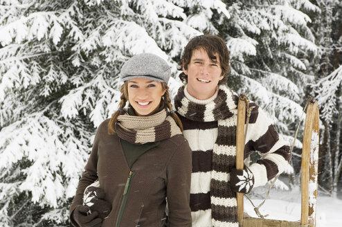 Austria, Salzburger Land, Altenmarkt, Young couple in snowscape, portrait - HH02588