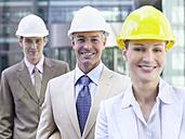 Germany, Baden-Württemberg, Stuttgart, Businesspeople wearing hard hats, portrait - WEST08639
