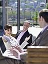 Germany, Baden-Württemberg, Stuttgart, Businesspeople taking a break, woman gesturing - WEST08620