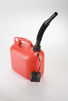 Red gas can on white background, close-up - JRF00044