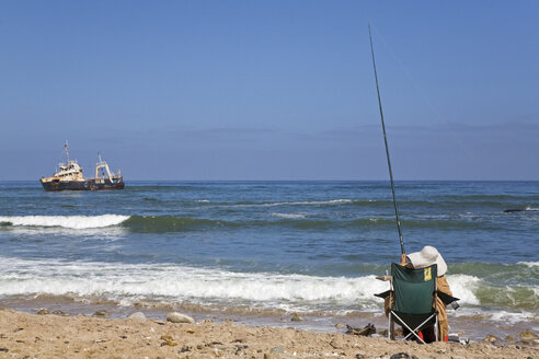 Africa, Namibia, Person fishing, rear view - FOF00864