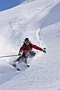 Austria, Tyrol, Zillertal, Gerlos, Freeride, Man skiing downhill - FFF00919