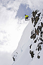 Austria, Tyrol, Zillertal, Gerlos, Freeride skiing, Man doing jump across rock - FFF00913
