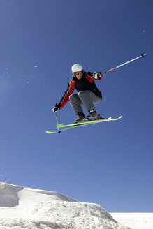 Italy, Tyrol, Monte Rosa, Freeride, Man jumping on skis - FFF00904