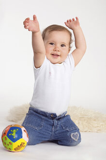 Baby girl (1-2) playing with ball, hands up - RDF00937