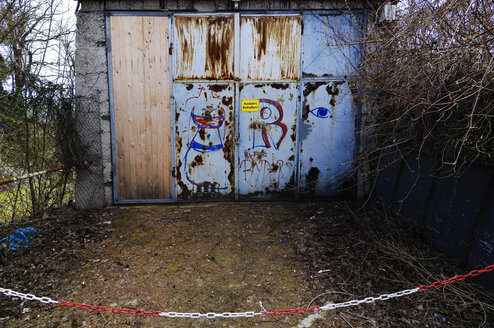 Germany, Bavaria, Munich, Garage door with graffiti - MBF00818