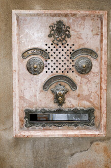 Italy, Venice, House facade, Face shaped mailbox, close up - AWDF00045