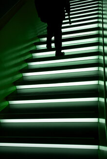 Man walking up stairs, low section - AWDF00006