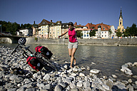 Germany, Bavaria, Bad Toelz, Woman fooling about on shore - DSF00139