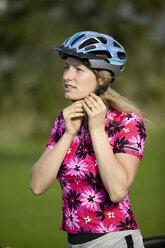Germany, Bavaria, Mittenwald, Woman wearing bike helmet, portrait - DSF00004