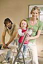 Family, Baby girl  (1-2) on step ladder, man preparing wallpaper - WESTF09181