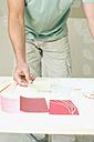 Person looking at wallpaper samples - WESTF09109