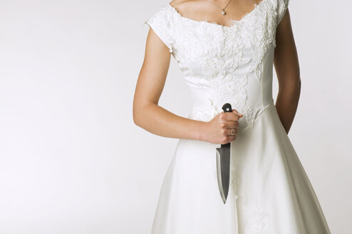 Bride holding knife, mid section - NHF00906