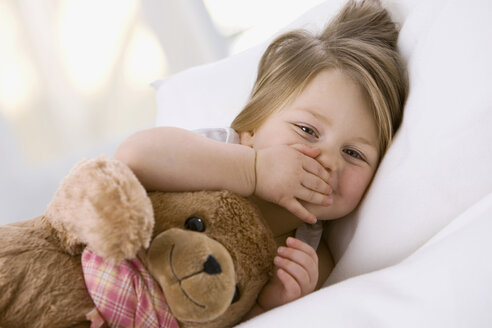 Little girl (3-4) playing with teddy bear - SMO00196
