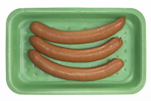 Wiener sausages in styrofoam box, elevated view - THF00903