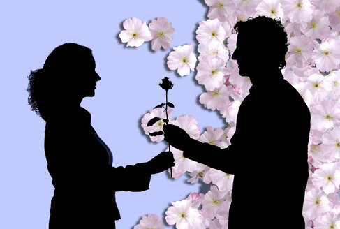 Silhouettes, Man giving young woman rose - IGOF00002