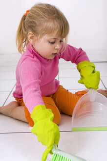 Little girl (4-5) playing with hand broom and dust pan - SMO00357