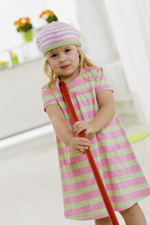 Little girl (4-5) playing with broom - SMO00342