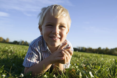 Little boy (2-3 years) lying in the meadow, smiling, portrait - SMO00279