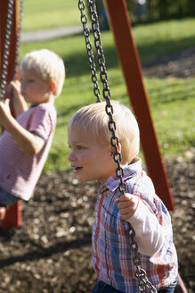 Two little boys ( 2-3) (4-5) sitting on swing - SMO00246