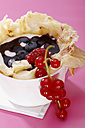 Crepes with yogurt, red fruit jelly and red currants, close-up - SCF00320