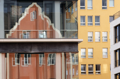 Reflection of an old building in a glass facade - 00450LR-U