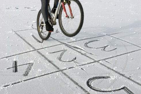 Person on bike on frozen lake - AWDF00266