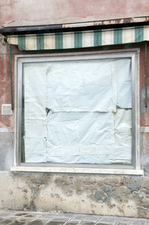 Italy, Venice, Shop window pased up with paper - AWDF00199
