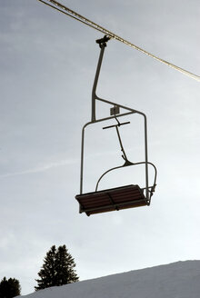 Germany, Allgaeu, Empty ski lift chairs - AWDF00082