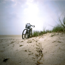 Germany, North Sea, Amrum, Bicycles on a dune - AWD00301