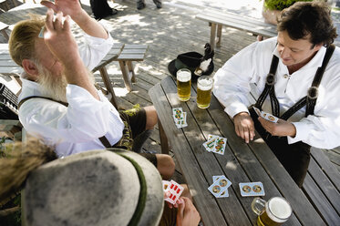 Germany, Bavaria, Upper Bavaria, Men playing cards in beer garden, elevated view - WESTF09645