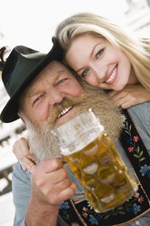 Germany, Bavaria, Upper Bavaria, Senior man and young woman, smiling, portrait, close-up - WESTF09611