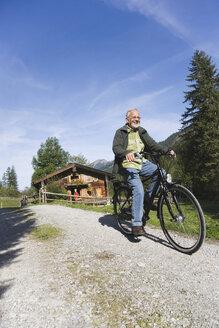 Austria, Karwendel, Senior man biking - WESTF10506