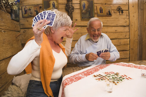 Senior couple playing cards - WESTF10455