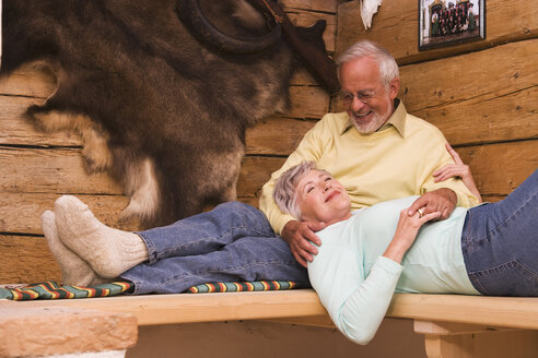 Senior couple in hunting lodge - WESTF10431