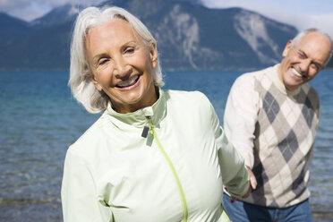 Germany, Bavaria, Walchensee, Senior couple walking hand in hand - WESTF10130