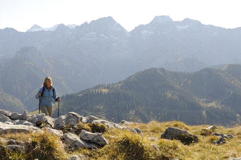 Austria, Karwendel, Rissbachtal, Woman Nordic Walking - MRF01131