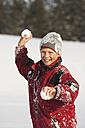 Austria, Steiermark, Boy (12-13) holding snowball, smiling, portrait - WWF00360