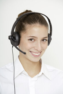Young woman (16-17) with earphones, close up - TCF01209