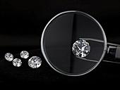 Magnifying glass over diamond - AKF00044