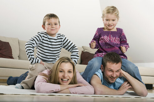 Family relaxing at home, smiling - CLF00671