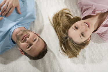 Young couple relaxing on carpet, elevated view - CLF00665