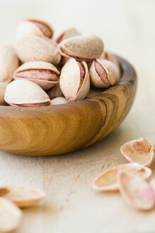 Pistachio nuts in wooden bowl. close-up - JR00067