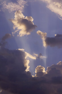 Sun rays shining through clouds, low angle view - RUEF00027
