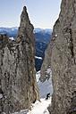 Austria, Salzburger Land, Werfenweng, Person skiing on steep slope - FFF01051