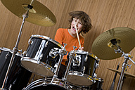 Germany, boy (12-13) playing drums - WDF00429