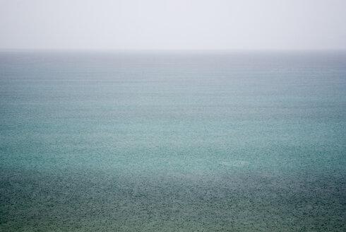 Greece, Ithaca, Rain showers over sea - MUF00788