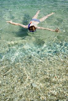 Greece, Ithaca, Woman snorkelling - MUF00776