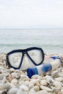 Snorkeling mask and snorkel on shingle beach - MUF00751