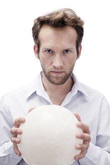 Young man with crystal ball, portrait - BMF00571